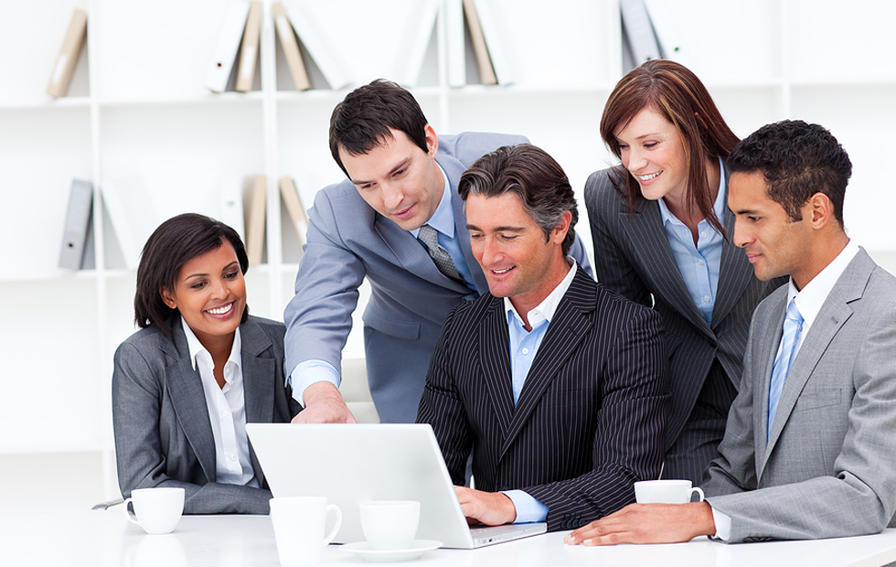 group of people in suits looking at a computer